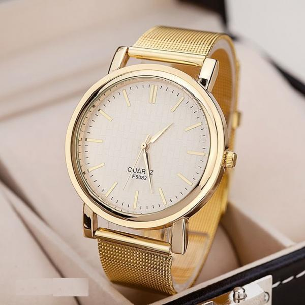 Luxury steel band gold colored woman watch